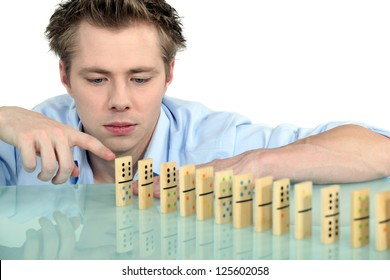 Man with a row of dominoes