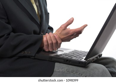 Man rubbing his wrist after typing too long on the laptop