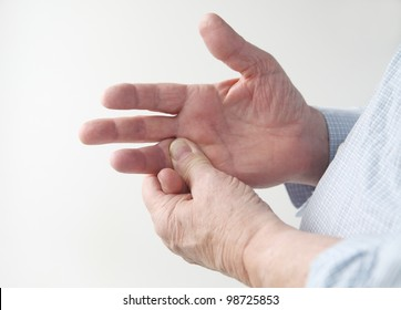 a man rubs the pain in his finger