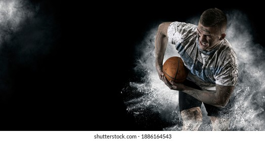 Man rugby player holds ball. Sports banner. Horizontal copy space background