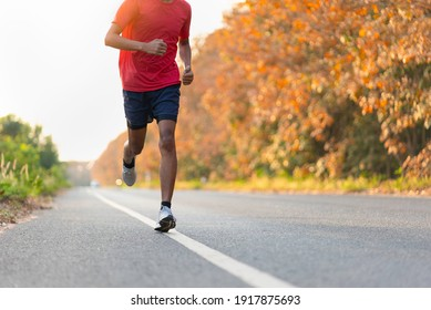 man runner athlete on the road to healthy, Young people running exercise on street.