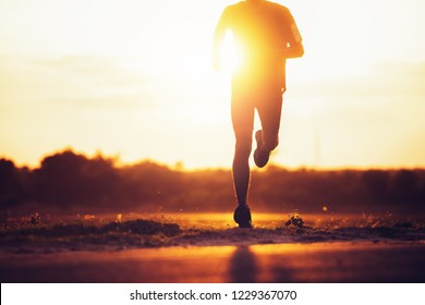 The man with runner on the street be running for exercise.