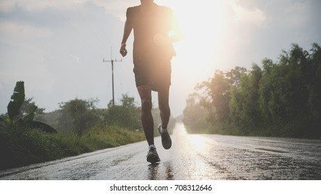 The man with runner on the street with raining be running for exercise.Run for health concept.