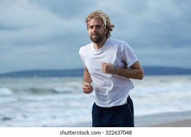 Man running along a beach