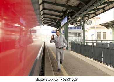 Man running to catch train for work