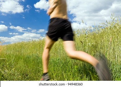 Man running cross country on trail, sport and fitness outdoors