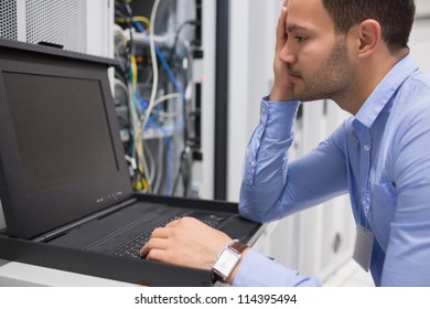 Man running diagnostics of servers in data center