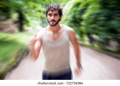 Man running fast in a park. Radial motion blur effect to give a dynamic look