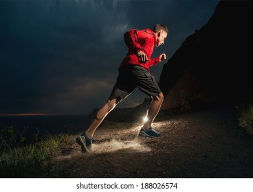 Man running in the mountains at night