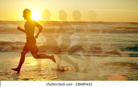Man running on the beach - motion blurred