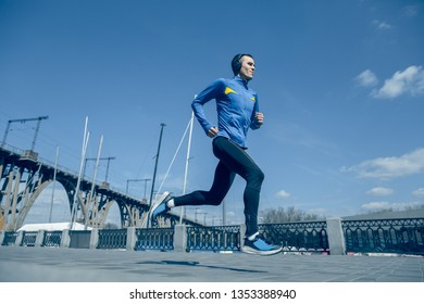 Man running on city background at morning. Healthy lifestyle concept.