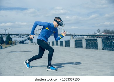 Man running on city background. Handsome athlete using VR glasses while runnig at morning. Healthy lifestyle and high tech concept.