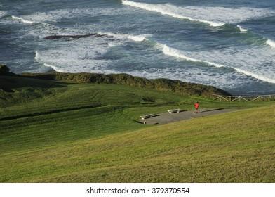 Man running on the coast