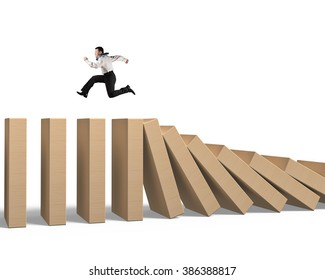 Man running on falling wooden dominoes, isolated on white background.