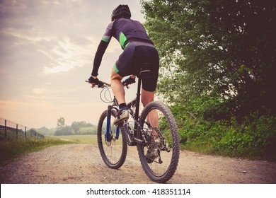 Man running on a mountain bike in the country