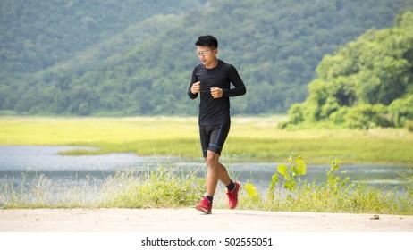 Man running on mountain road