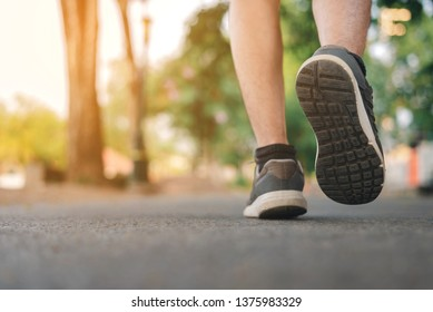 Man running on the park with Close up shoes