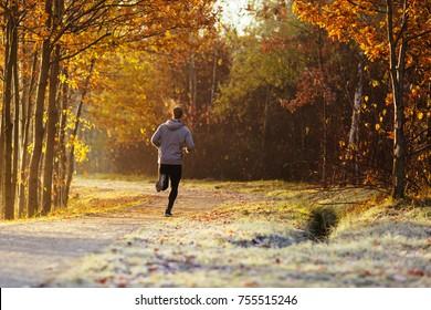 Man running outdoors on cold autumn morning