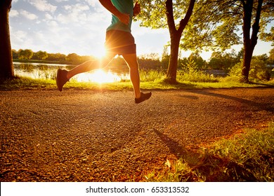 man running in park during sunset