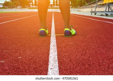 Man running in stadium
