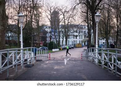 Man running trough Utrecht in de early morning, Netherlands, december 2019