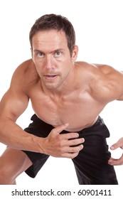 A man is running very hard.