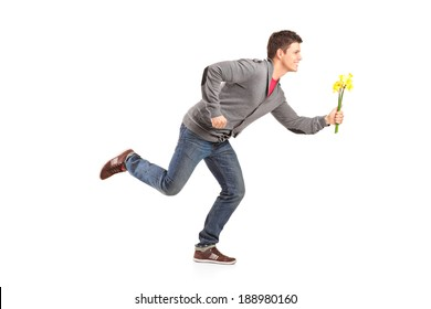 Man running with yellow tulips in hand isolated on white background
