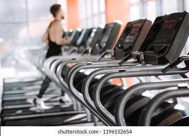 man runs on a treadmill in the gym