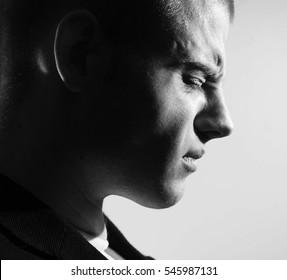 Man sad profile, black and white portrait