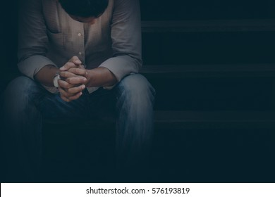 A man are sad and stressed in black background