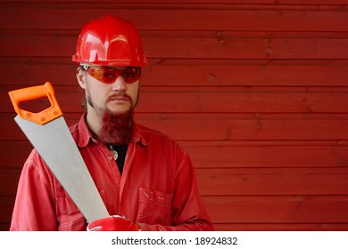 man with safety helmet and handsaw