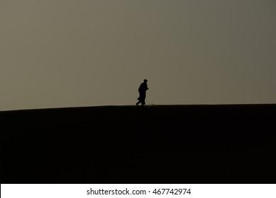 Man in the Sahara desert