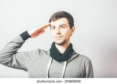 man salutes