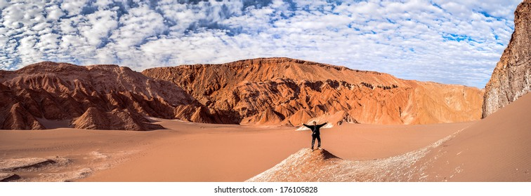 Man salutes nature in Death Valley (Valle de la Muerte), San Pedro de Atacama, Chile