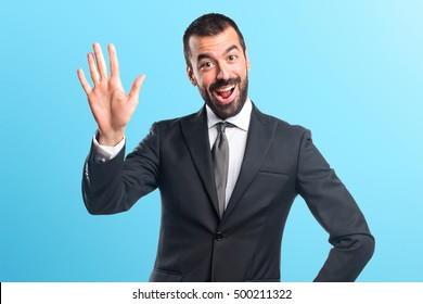 Man saluting over colorful backgound