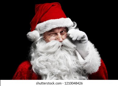 Man in santa claus costume winking