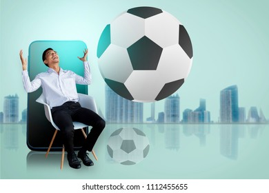 Man satisfy or be satisfied business with smart phone on city blurry background with football tournament 2018 