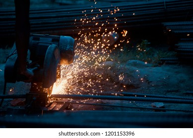 Man sawing a metallic object unique blurry photo