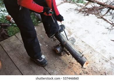 man sawing wood