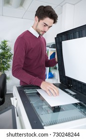 man scanning a document