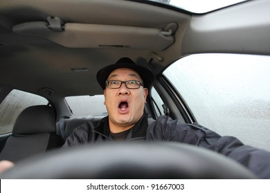 Man scared while driving a car.