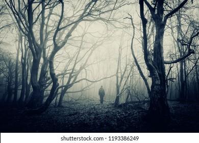 man in scary halloween forest, dark fantasy landscape