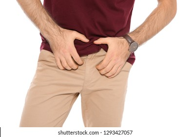 Man scratching crotch on white background, closeup. Annoying itch