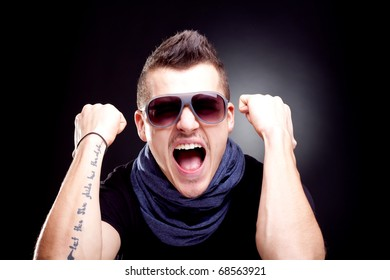 man screaming with fists in the air - studio shot