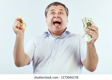 Man screams with delight from bitcoin and dollars, he won. He likes crypto currency.