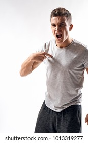 man screams on a light background, strong