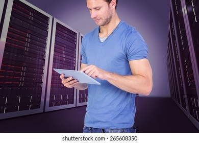 Man scrolling through tablet pc against server hallway