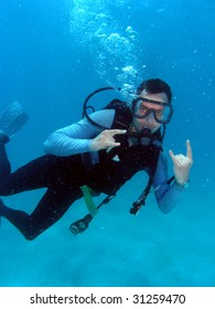 Man Scuba Diving in Great Barrier Reef