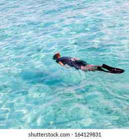 man in the sea with the equipment for a snorkeling