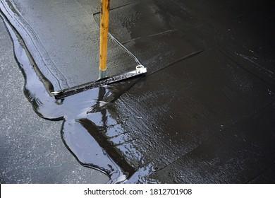 Voie d'accès asphaltée scellée par l'homme/mise au point sélective de l'alcôve